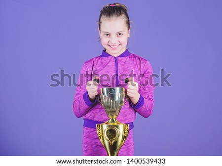 Celebrating childrens achievements great and small. Sport achievement. Celebrate victory. Girl hold golden goblet. Importance of capturing evidence of kids progress. Proud of her achievement. #1400539433