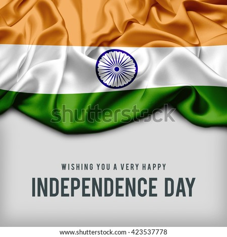 Celebrating India Independence Day. Abstract waving flag on gray background