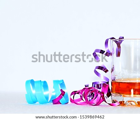 Celebrating New Years with some rum and streamers no people stock photo