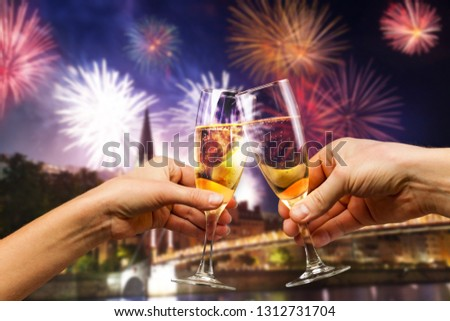Celebration and firework with glasses of champagne #1312731704