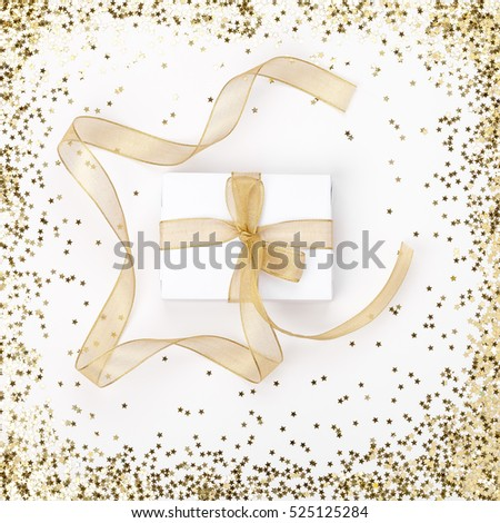 celebration and holiday composition. christmas, birthday, wedding or anniversary gift on white background with star glitter frame. trendy concept for postcard or invitation