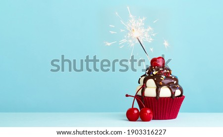 Celebration cupcake with cherry and sparkler Photo stock ©