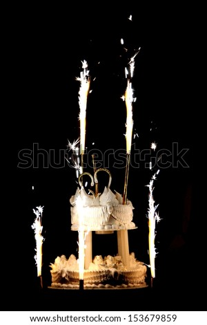 Celebration! Flaming Wedding Cake against black background