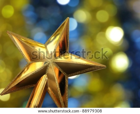 Celebration golden star on the shining color background