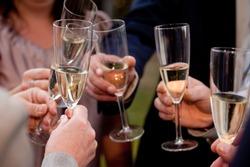 Celebration. Hands holding glasses of champagne.