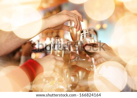 Shutterstock Celebration. Hands holding the glasses of champagne and wine making a toast.