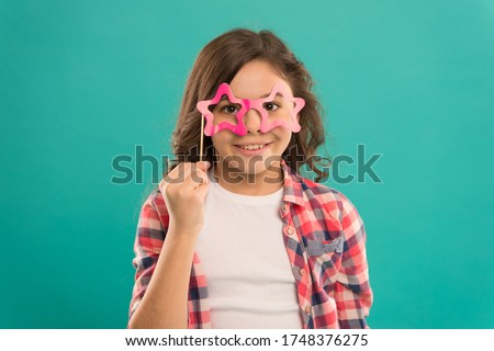 Celebration. Happy little child. Party decorations. Party shop. Start this party. Hey just have fun. Funny small girl holding glasses photo booth props on stick. Cute kid with fancy party props.