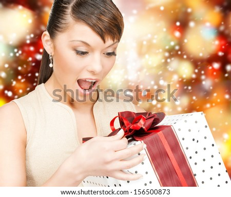 celebration, holidays, xmas concept - happy woman with gift box - stock photo