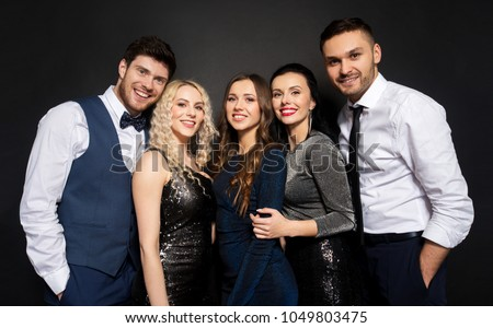 celebration, people and holiday style concept - happy friends in party clothes over black background #1049803475