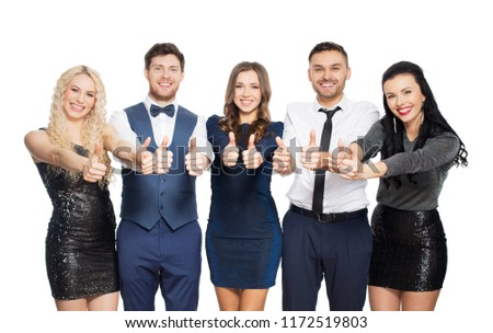 celebration, people and holiday style concept - happy friends in party clothes showing thumbs up