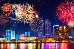 Celebration. Skyline with fireworks light up sky over business district in Ho Chi Minh City ( Saigon ), Vietnam. Beautiful night view cityscape. Holidays, celebrating New Year.