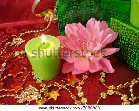 celebration table (candles, flowers and gift on red background)