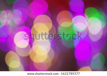 Celebratory background from multi-colored circles. Defocused shooting of colored light sources.