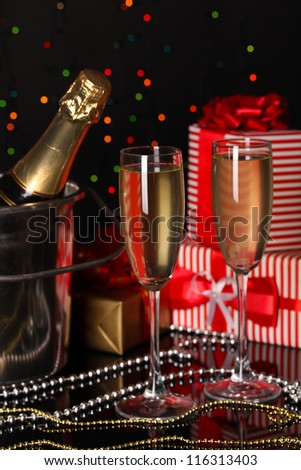 Celebratory champagne with stemware on Christmas lights background