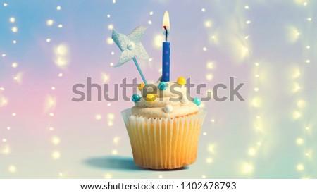 Celebratory Cupcake With A Decorative Lit Candle 1402678793