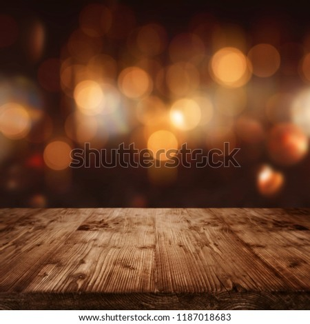 Celebratory dark background with golden bokeh and empty wooden stage