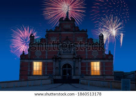 Celebratory fireworks for new year over The Borsen, Oldest Building in Slotsholmen, in Copenhagen, Denmark with the famous dragon spire up roof during last night of year. Christmas blue atmosphere  Stock fotó ©