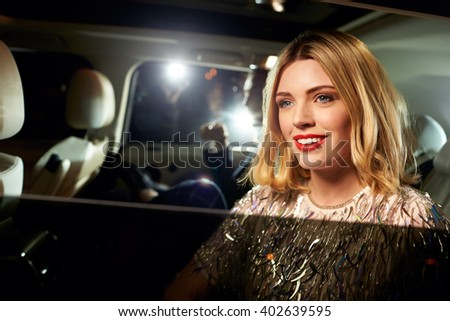 Celebrity couple arriving in limo, photographed by paparazzi