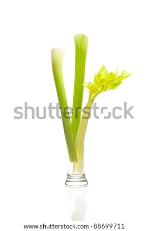 celery in a tall glass isolated on white