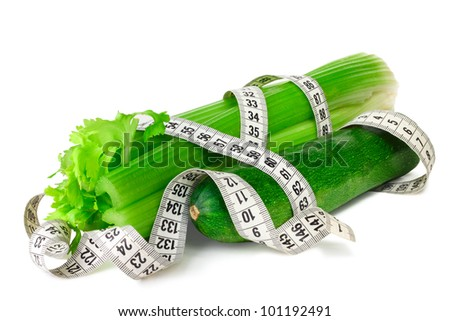 Celery zucchini squash and measure tape diet concept isolated on white
