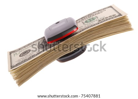 Cell phone and dollars close up. On white background