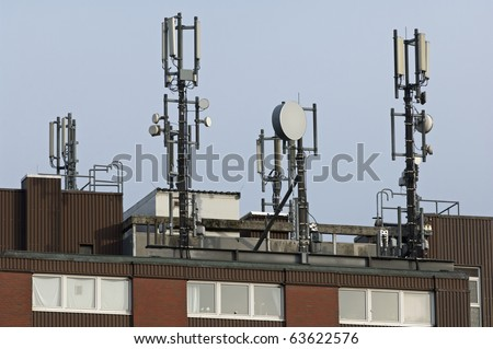 cell phone antennas on the roof of building in Kiel, Germany