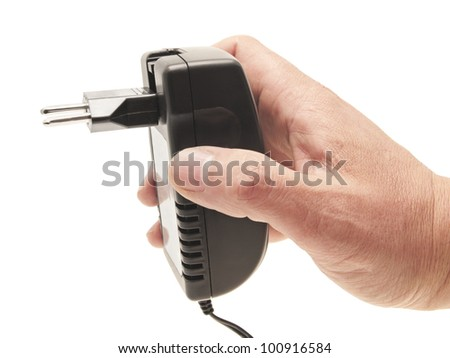 Cell phone charger in a man's hand. On a white background.