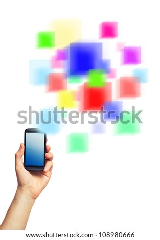 Cell phone (smartphone with touchscreen) in male hand and a futuristic digital depiction of social media over white background