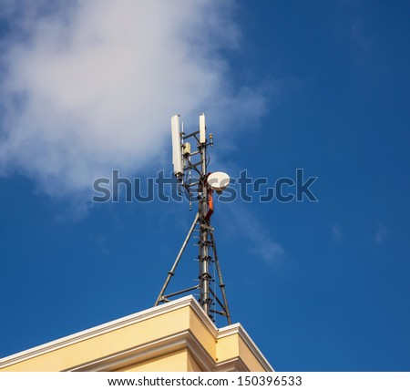 Cell Phone Tower and blue sky with cloud