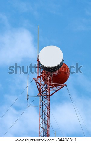 Cell phone tower isolated against sky background.
