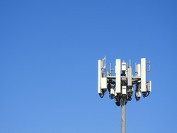 Cell Tower - Mobile Phone Tower - Right side of Image - Clear Blue Sky