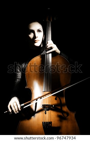 Cello classical musician cellist performer. Woman with musical instrument on black background