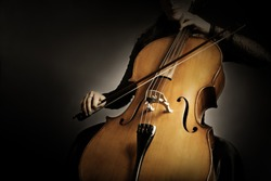 Cello player. Cellist hands playing violoncello orchestra music instrument closeup