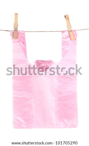 Cellophane bag hanging on rope isolated on white