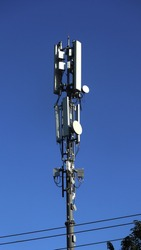 Cellular  Communication tower on blue sky background