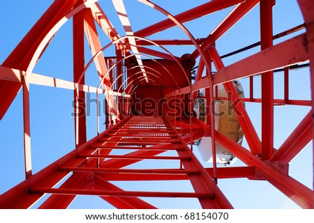 Cellular communications tower on a clear day the blue sky - stock photo