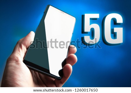 Cellular. 5G. Cellular telephone. 5G broadband network. The fifth generation of mobile communications. Phone in hand. Data transfer rate Communication standard #1260017650