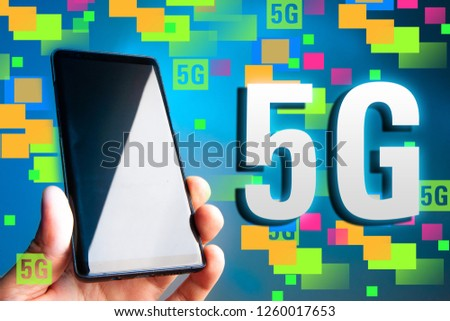 Cellular. 5G. Cellular telephone. 5G broadband network. The fifth generation of mobile communications. Phone in hand. Data transfer rate Communication standard #1260017653