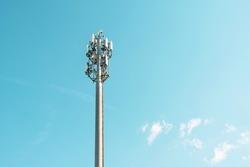 Cellular macro Base Transceiver Station. Telecommunication tower. Wireless Communication Antenna Transmitter. Development of communication systems in urban area blue sky