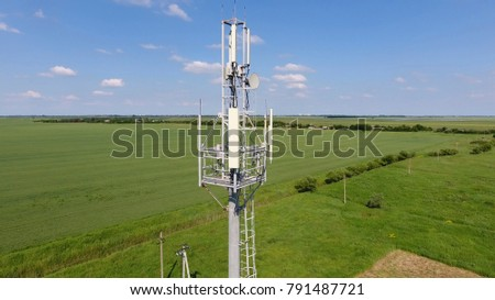Cellular tower. Equipment for relaying cellular and mobile signal. Fly around up and down. #791487721