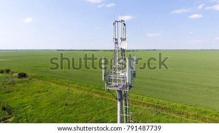Cellular tower. Equipment for relaying cellular and mobile signal. Fly around up and down. #791487739