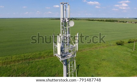 Cellular tower. Equipment for relaying cellular and mobile signal. Fly around up and down. #791487748