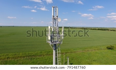 Cellular tower. Equipment for relaying cellular and mobile signal. Fly around up and down. #791487760
