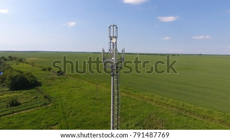 Cellular tower. Equipment for relaying cellular and mobile signal. Fly around up and down. #791487769