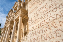 Celsus Library in ancient city Ephesus at sunset near Selcuk, Turkey. Ancient greek inscriptions on the wall of archeological ruins in ancient Ephesus city, Turkey