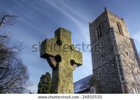 Celtic Cross and Church Tower at St Peter's Weston, Suffolk, England. HDR processing shows tiny moon in sky!