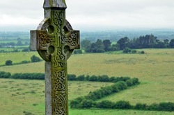 Celtic cross in Ireland. Big celtic gravestone with moss and lichen.