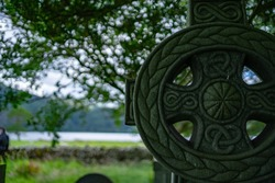 Celtic gravestone with nature in background