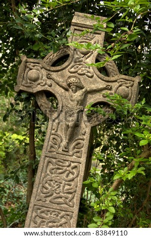 Celtic style cross with Jesus on the front.  Taken in English graveyard.