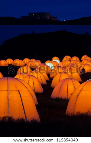 Cemaes Bay Peace Camp an artwork of lighted tents and poetry bring read throughout the night Isle of Anglesey